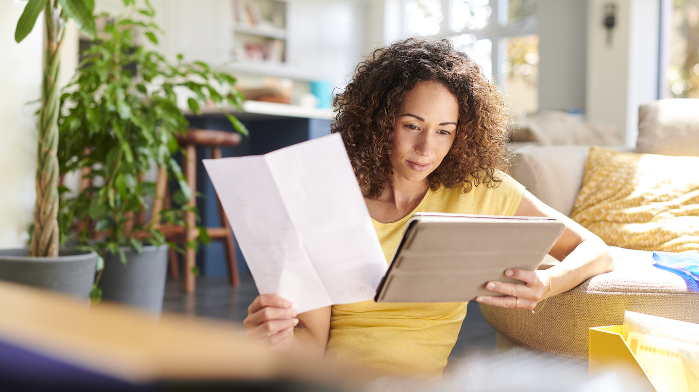 woman comparing secured and unsecured loan on her tablet