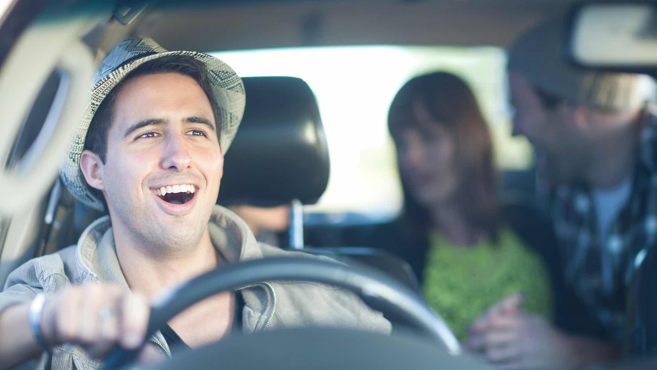Driver in car happy with insurance features