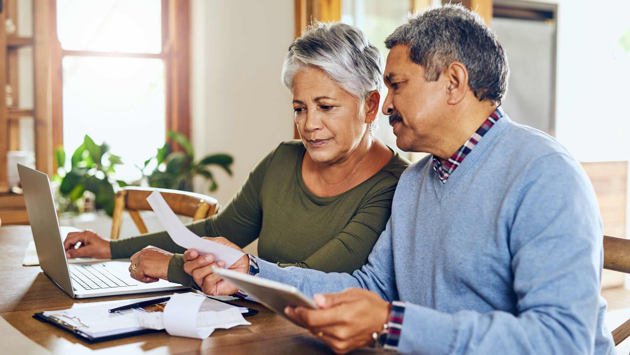 Older couple looking at life insurance documents