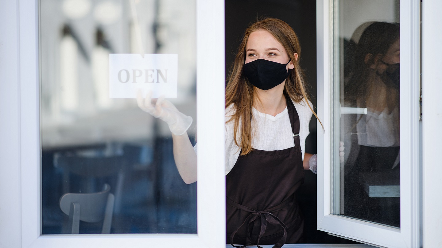 Woman business owner opening her cafe