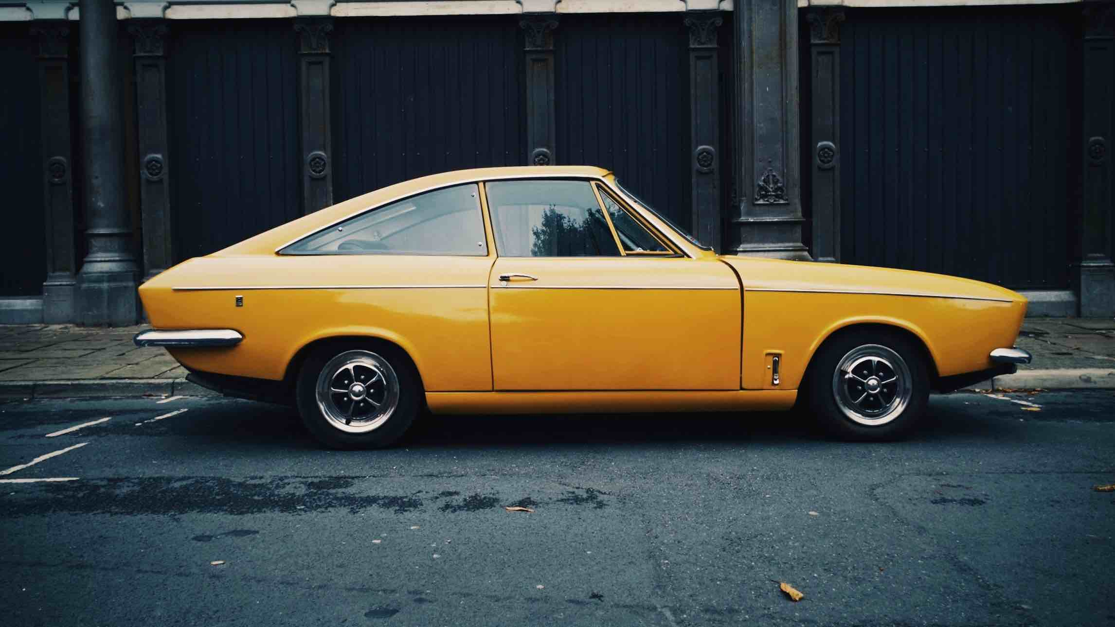 Classic yellow car with insurance