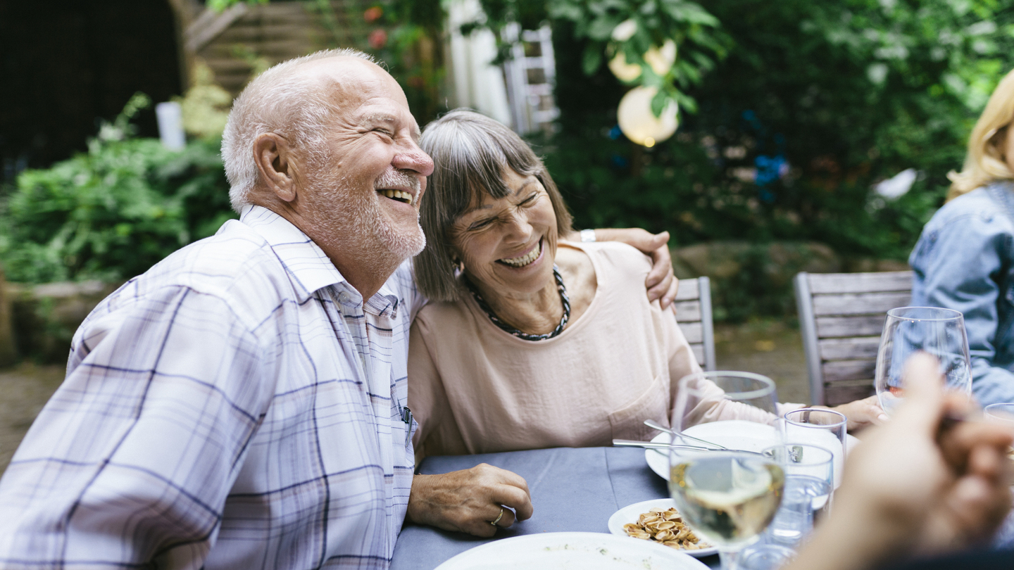 elderly-couple-smiling-approved-for-pensioner-loan