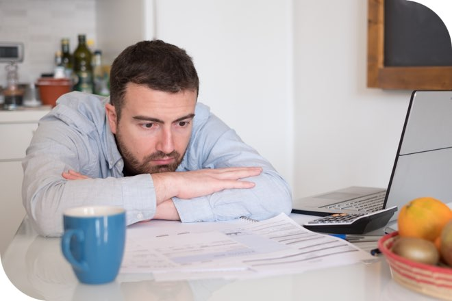 Man looking sad at not paying credit card original
