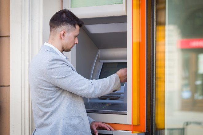 Man withdrawing cash from overseas atm original