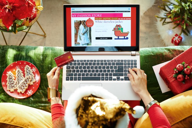 Woman online shopping for christmas original
